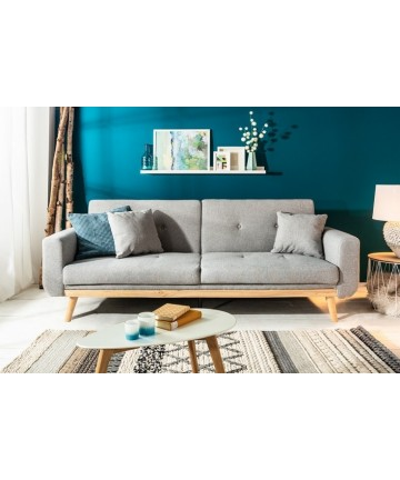 Szara sofa rozkładana styl skandynawski