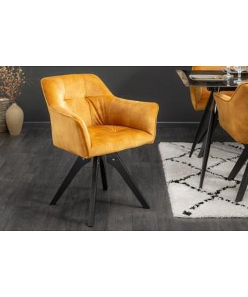 Żółte welurowe krzesło z podłokietnikami